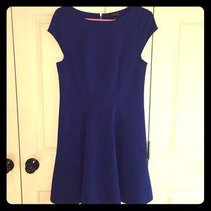 Blue cocktail length dress